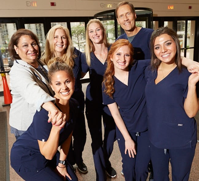 The Warwick Dentistry team smiling together